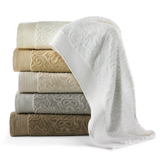 Stack of cotton bath towels with a classic damask pattern in white, linen, ivory, flint, and driftwood