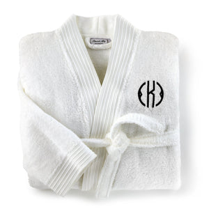 folded white bamboo bathrobe with monogram