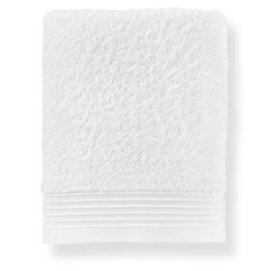 folded white cotton bath towel