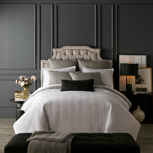 moody glam bedroom with black white and gray bedding