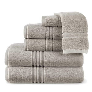 folded stack of gray bath towels