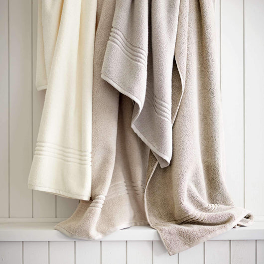 hanging bath towels in neutral colors