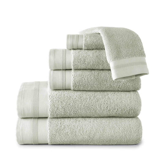 stack of green folded turkish cotton bath towels