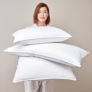Down Alterative Pillows held by model
