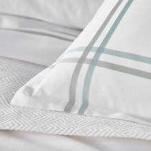 Load image into Gallery viewer, detail photo of corner of striped pillow sham in sage