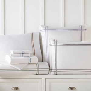 Duo multi colored trim sheets on dresser