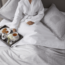 Load image into Gallery viewer, elise jacquard sham woman in bathrobe eating breakfast in bed