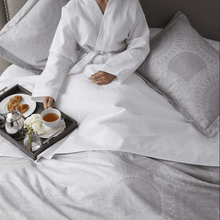 Load image into Gallery viewer, woman in bathrobe eating breakfast in bed
