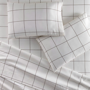 Emily Egyptian cotton sheet set in square pattern on bed