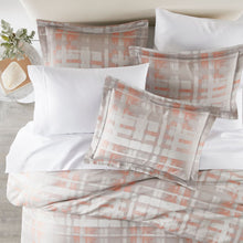 Load image into Gallery viewer, lifestyle image of Enzo shams and duvet in coral with white sheeting