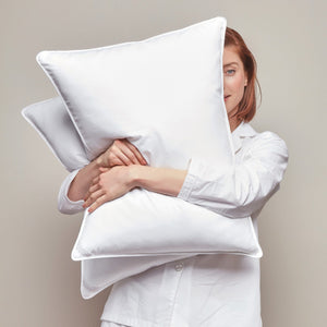 Down Alternative Pillow held by Model close