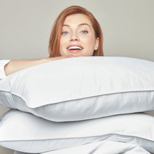 Load image into Gallery viewer, woman holding goose down pillow inserts