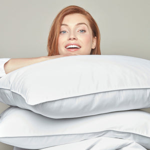 woman holding goose down pillow inserts