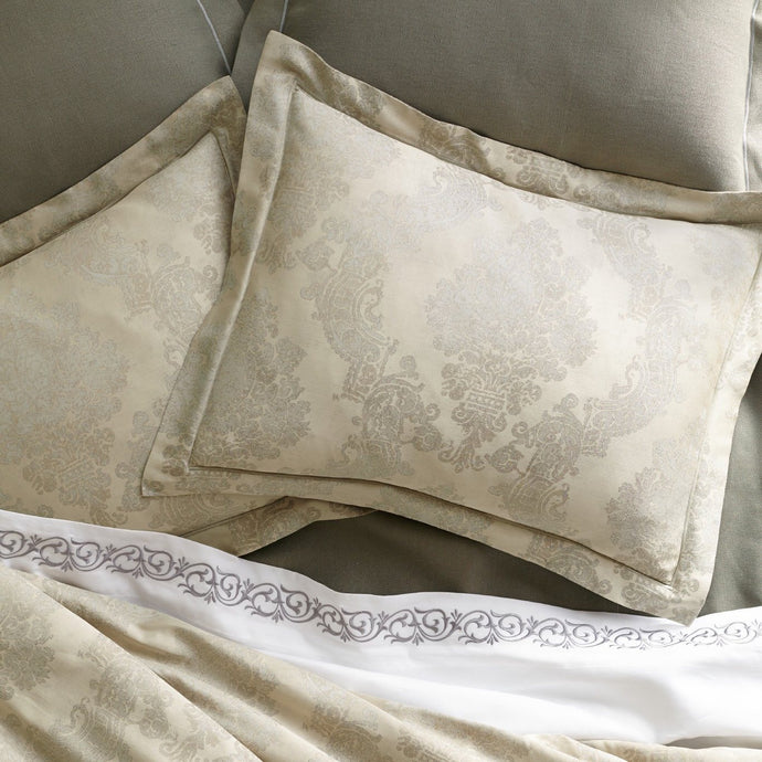 Two Italian jacquard shams in platinum color with hues of champagne and grey