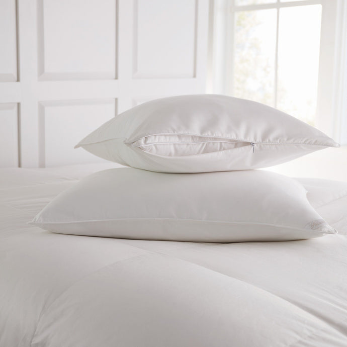 Stacked Pillow Protectors on bed
