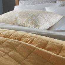 Load image into Gallery viewer, detail shot of honey 4 square quilted coverlet on bed