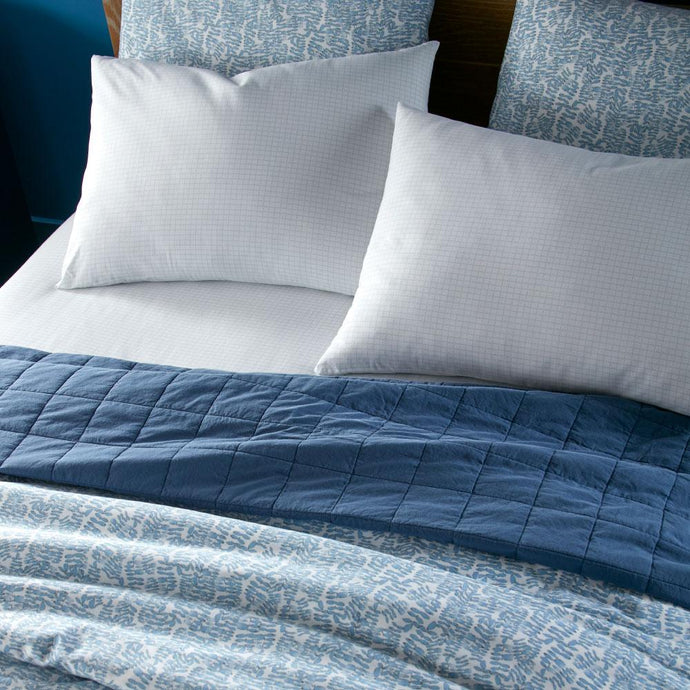denim blue Grid percale sleeping sham on bed