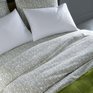 olive green Fern duvet cover sleeping shams and fitted sheet on bed