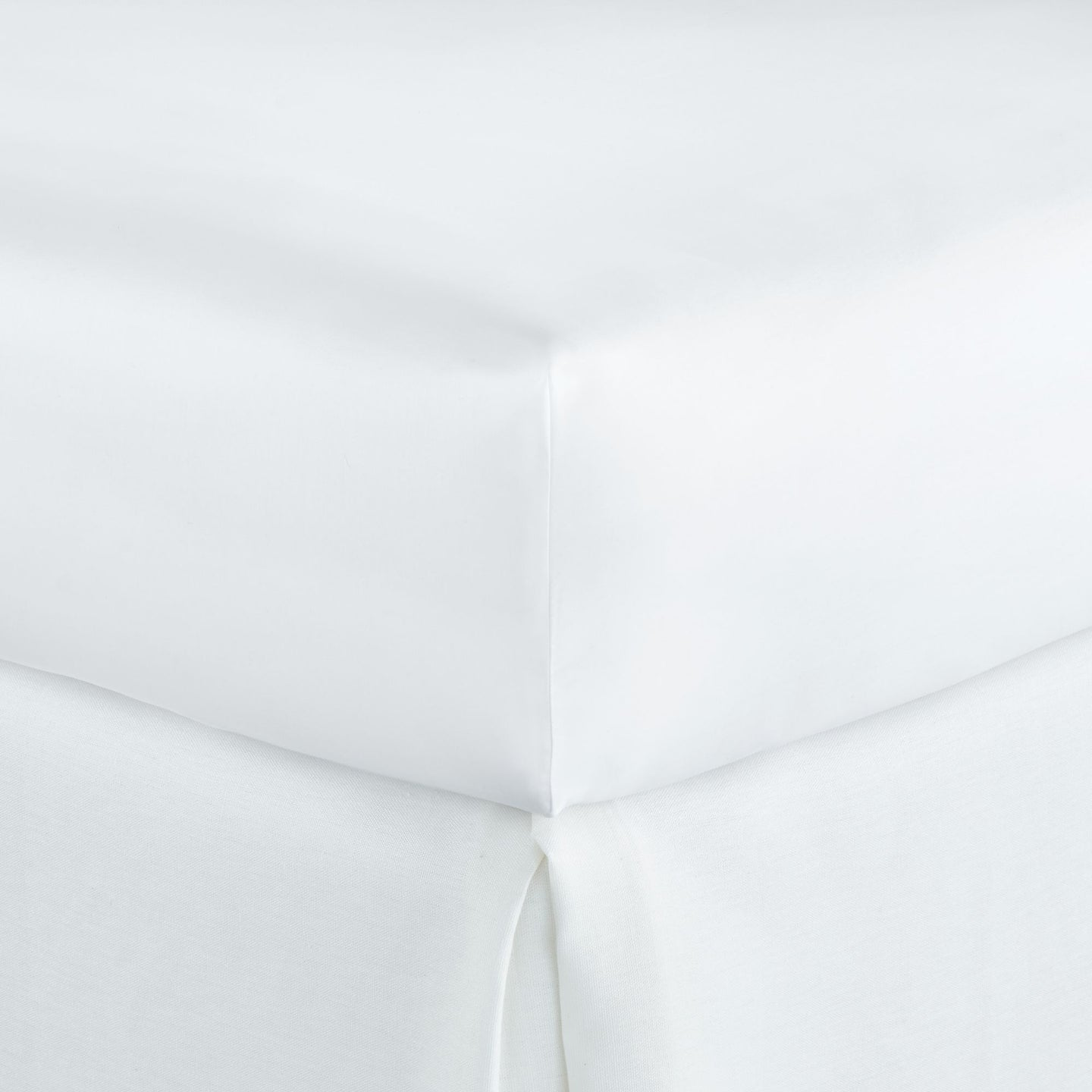 Harmony White fitted sheet tucked into mattress