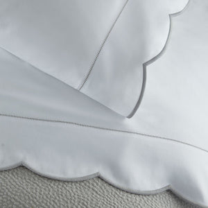 scalloped pillow case and flat sheet with grey embroidery