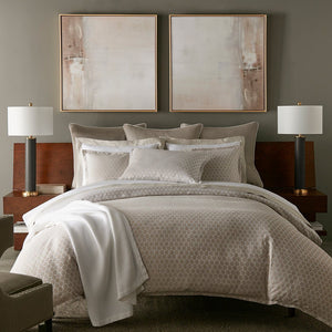 neutral bedroom with gray and white bedding and scalloped sheets and pillow cases
