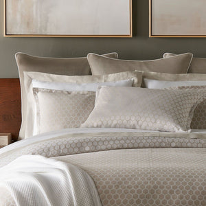 honeycomb patterned duvet and shams with neutral bedding