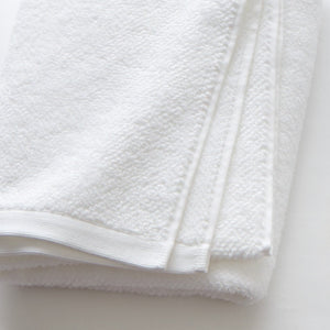 up close detail shot of white cotton bath towels