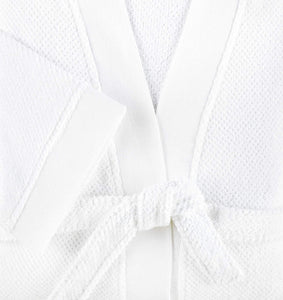 detail shot of white cotton bath robe