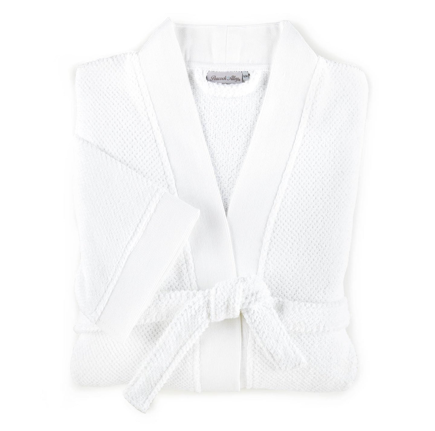folded white cotton bath robe