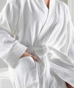 woman in white bath robe hand in pocket