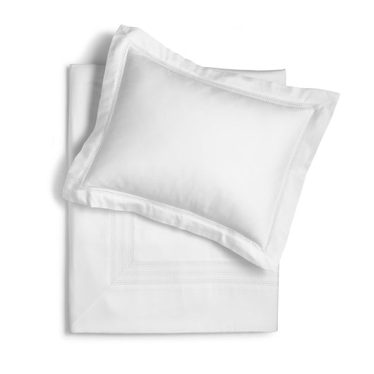 Flat lay of a white sateen sham and white sateen duvet cover
