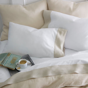 Linen cuff percale flat sheets and pillow cases with a book and coffee cup