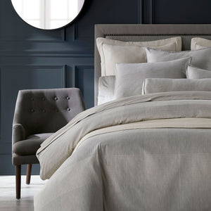Matteo plaid pewter bedding styled in navy bedroom