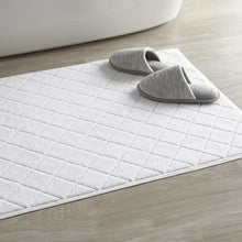 Load image into Gallery viewer, White slippers on top of lattice bath rug
