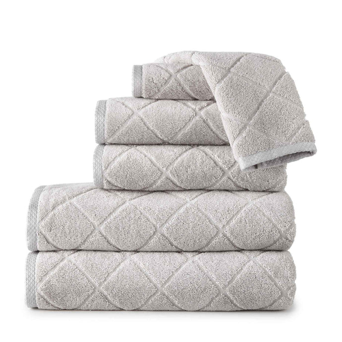 stack of gray lattice diamond pattern bath towels