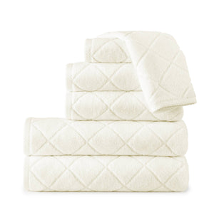 ivory colored stack of diamond pattern bath towels
