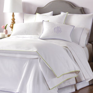 white pique bedding with lilac and spring colored trim