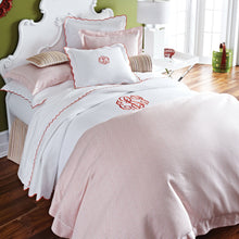 Load image into Gallery viewer, Monogrammed bed with red dotted geometric patterned sateen duvet cover