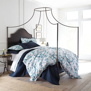 Aqua green French medallion sateen duvet cover and sateen sham in a canopy bed