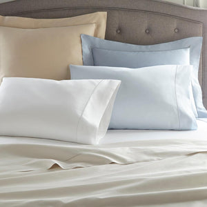 Soprano sateen sheets and pillow cases in various colors on bed