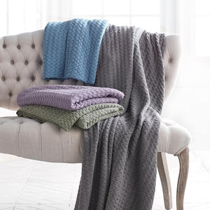 Faro throw Blankets multi colors on antique chair