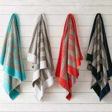 Load image into Gallery viewer, Soleil Striped Beach Towel various colors hanging on wall