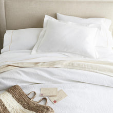 Load image into Gallery viewer, White bed with French medallion matelasse coverlet and shams