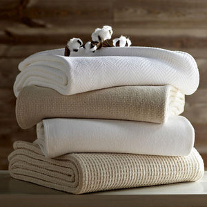 Stack of folded cotton blankets