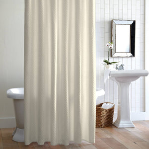 Alyssa Ivory shower curtain hanging in front of tub in bathroom with mirror and sink