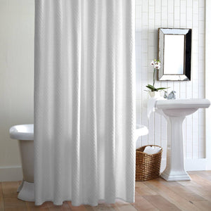 Alyssa white shower curtain hanging in front of tub in bathroom with mirror and sink