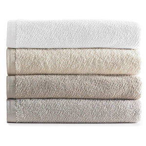 stack of neutral colored cotton bath towels