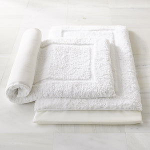 two white memory foam cotton bath rugs