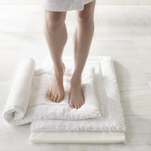 Load image into Gallery viewer, woman standing on white memory foam bath rug