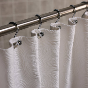 Detail of a white French medallion matelasse luxury shower curtain